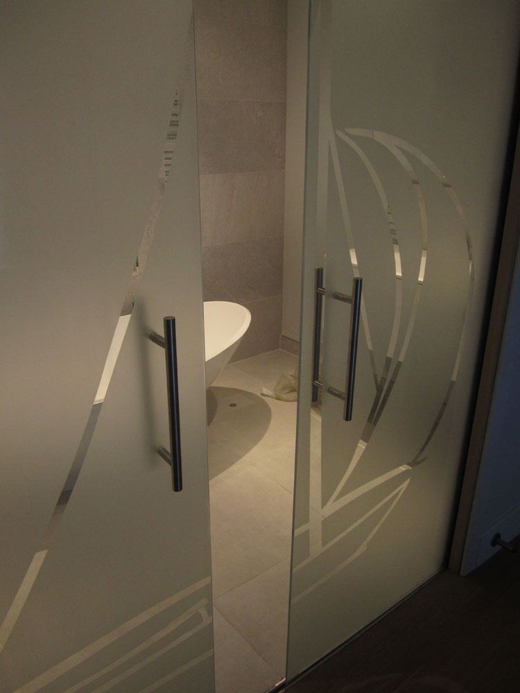 Veon glass bespoke structural glass solutions sliding for Frameless glass doors